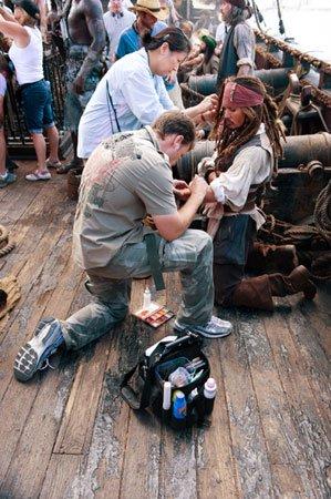 Karen adjusts Johnny Depp's wig.  Image Source