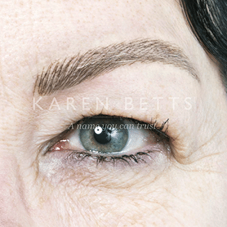 Tracy's brows after